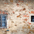 Wall with old windows — Stock Photo
