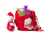 Red christmas sack and snowman, isolated — Stock Photo