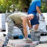 Man at work paving stones — Stock Photo