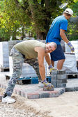 Man at work paving stones — Stock Photo
