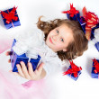 A little girl with the gifts - Stock Photo