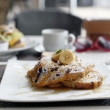 Cinnamon raisin french toast with maple syrup and french bananas — Stock Photo
