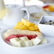 Healhty breakfast with assortment of fresh fruits, cereal muesli and fresh — Stock Photo #7913564