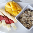 Healthy breakfast with cereal muesli and assortment of fresh fruits — Stock Photo