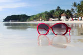 Pink retro sunglasses on the philippines beach — Stock Photo