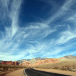 Wispy desert highway clouds. — Stock Photo