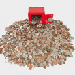 Children's Bank with Giant Pile of Coins — Stockfoto #7945206