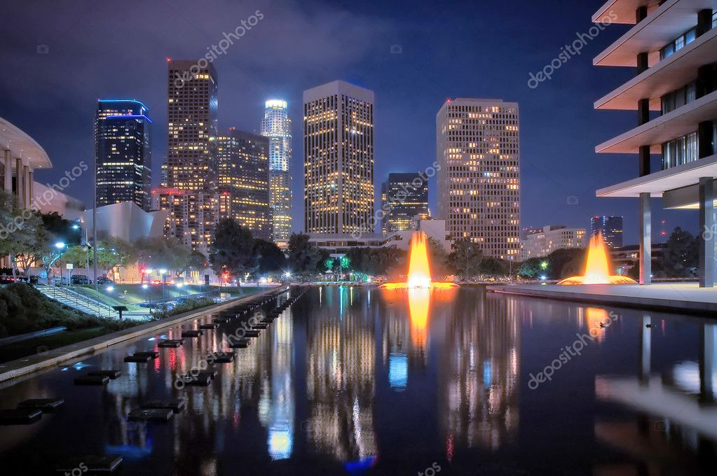The skyline of Los Angeles after dark, with fountains. — Stock Photo #7933488