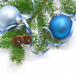 Pine branch with pine cones and Christmas decorations on a white background — Stock Photo