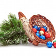 Cornucopia of chocolate balls and pine-branch. — Stock Photo
