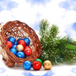 Royalty-Free Stock Photo: Cornucopia of chocolate balls and pine-branch.