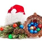 Cornucopia of chocolate balls and pine-branch. — Stock Photo #7920860