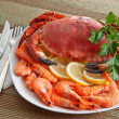 Crab with shrimp and parsley on a wooden table — Stok fotoğraf