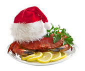 Crab in Santa Claus hat on a platter — Stok fotoğraf