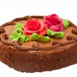 Chocolate cake with two cream-colored roses. Isolated on white background. — Stock Photo