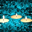 Lighted candles on a blue background — Stock Photo