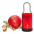 Red candle with Christmas ball isolated on white background. — Stock Photo