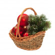Royalty-Free Stock Photo: Christmas decorations and a branch of pine in a wicker basket