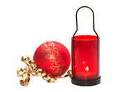 Red candle with Christmas ball isolated on white background. — Stok fotoğraf