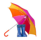 Rubber boots and a colorful umbrella isolated on a white background. — Stock Photo