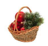 Christmas decorations and a branch of pine in a wicker basket — Stock Photo