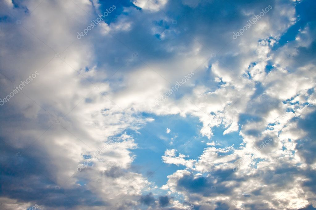 Blue sky with clouds and sun. — Stock Photo #7942286