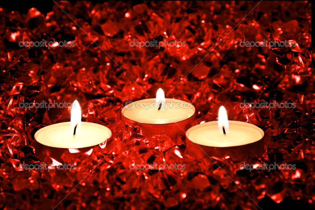Lighted candles on a red background — Stock Photo #7945697