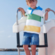 Boy on a catamaran in the Mediterranean - Stock Photo