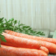 Fresh carrots with green leaves - Stockfoto