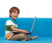Boy with laptop isolated on white background — Stock Photo
