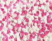 Colorful sweet candy hearts background — Stock Photo