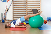 The girl at the gym with a ball — Stock Photo