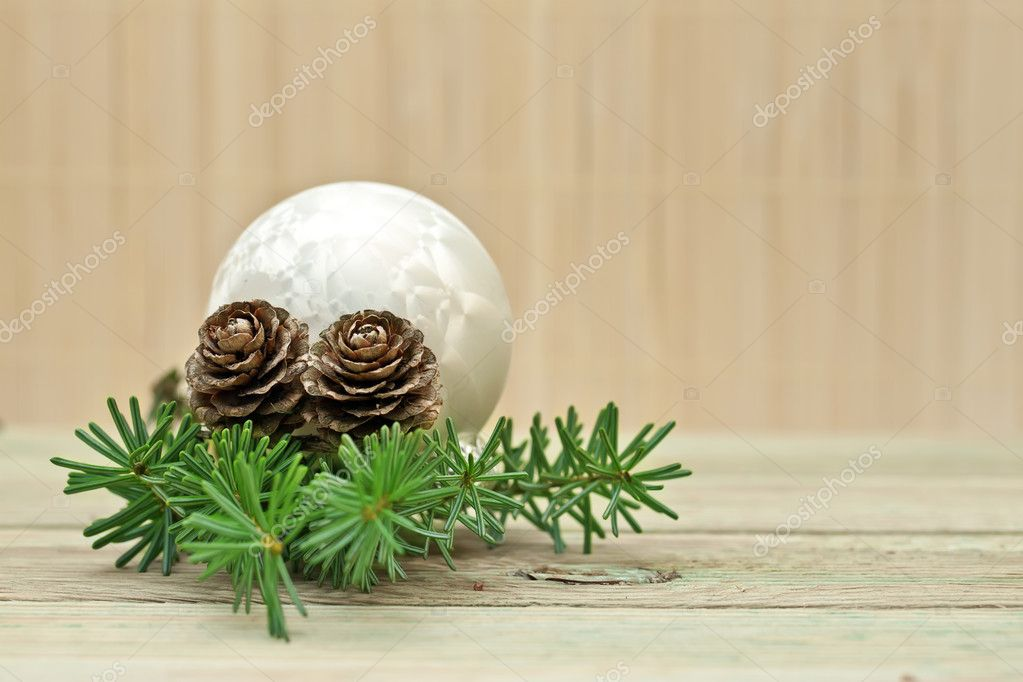 Pine branch with pine cones and Christmas decorations on a board background.  Stock Photo #7958391