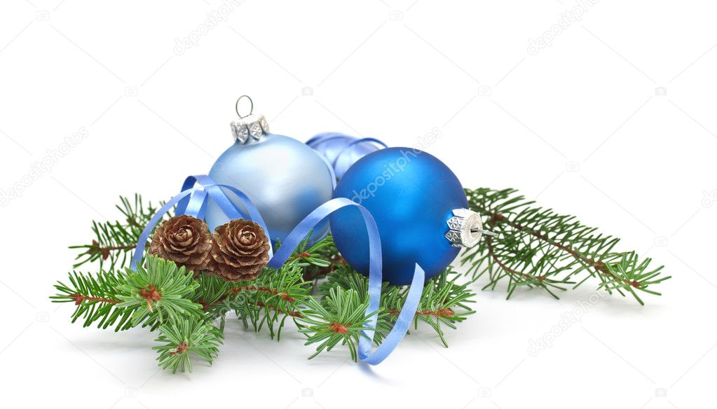 Pine branch with pine cones and Christmas decorations on a white background.   #7958683
