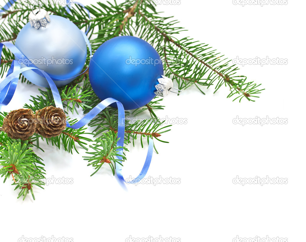 Pine branch with pine cones and Christmas decorations on a white background.  Stock Photo #7958695