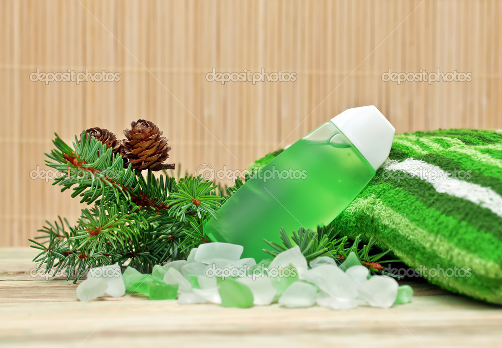Coniferous extract bath with a sprig of pine needles, pine cones and bath salts. — Stock Photo #7958835
