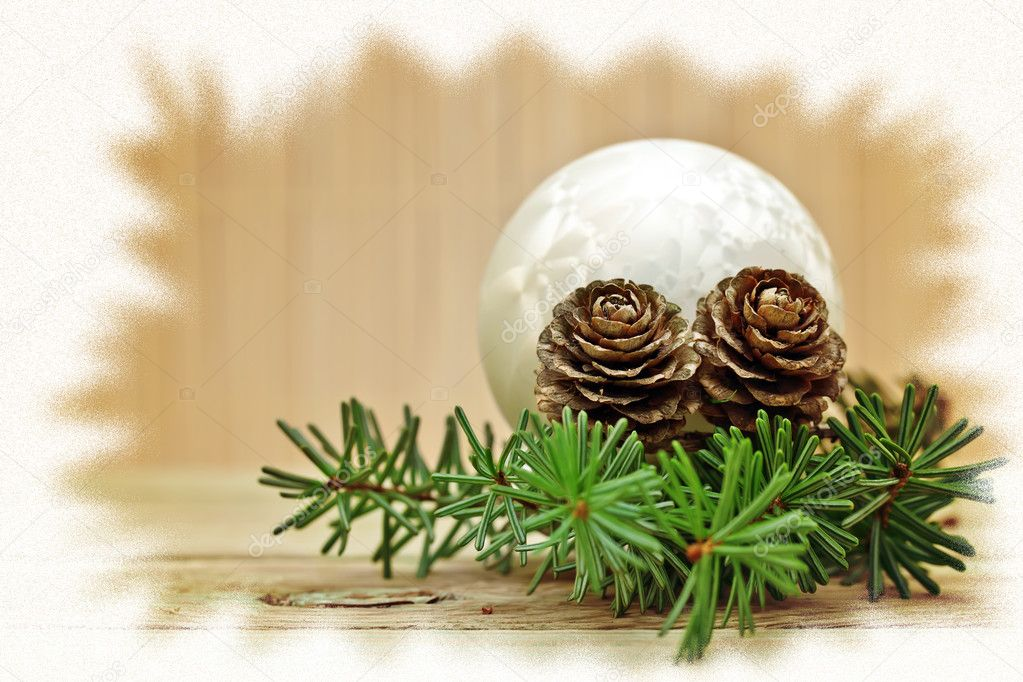 Pine branch with pine cones and Christmas decorations on a board background.  Stock Photo #7959310