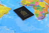 Canadian passport on the map — Stock Photo
