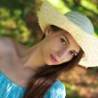 Girl in blue dress and hat — Stock Photo