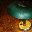 Old green lamp on the old table — Stock Photo