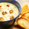 Cheese soup with toasts in blue pottery — Stock Photo #7915689