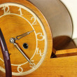 Old wooden clock with metal hands — Stock Photo