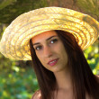 Young woman in straw hat — Stock Photo