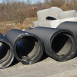 Big black tubes on the constructions area — Stock Photo