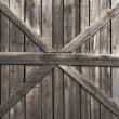 Old wooden door with big cross for background — Stock Photo