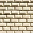 Wall for background texture with creamy bricks — Stock Photo