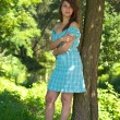 Girl in blue dress in the park — Stock Photo #7918203