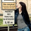 Attractive young woman licks danger sign — Stock Photo #7918754