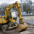 Resting excavator on the building place — Stock Photo