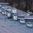 Stock Photo: Flat roof with many chimneys